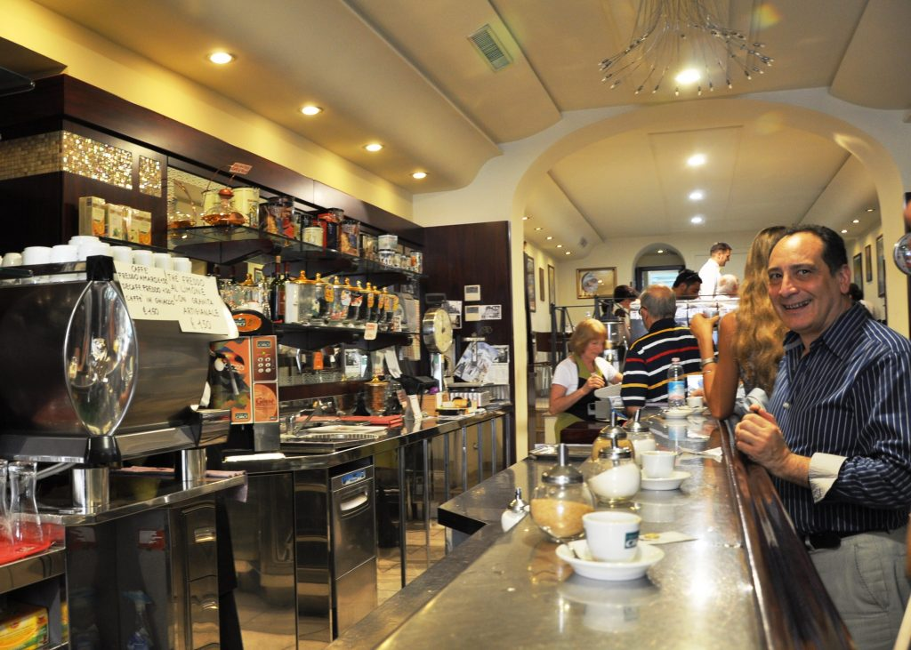 Italian coffee bar. Everyone is standing.
